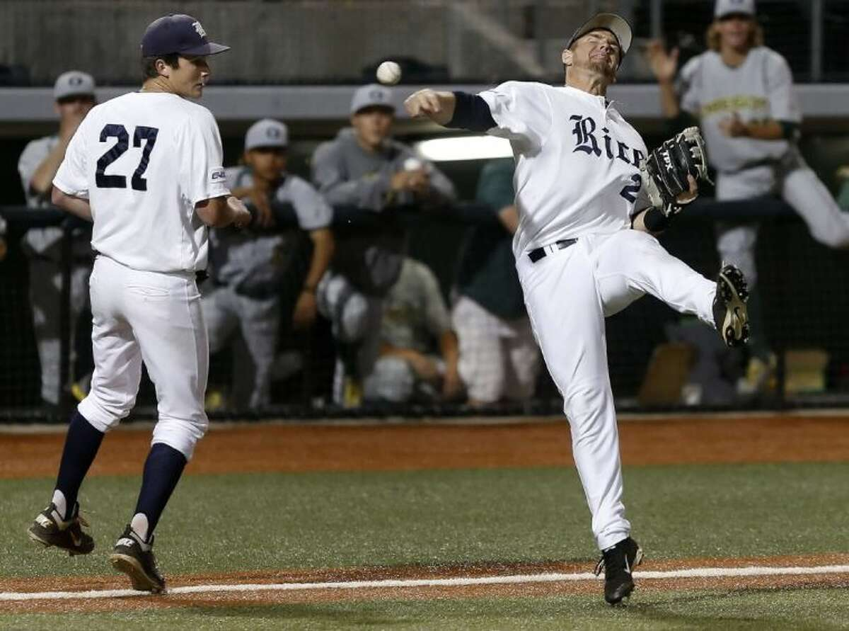 Rice third baseman Shane Hoelscher, right, throws after fielding a bunt attempt by Oregon during Rice's 1-0 victory over Oregon. At left is Rice pitcher Jordan Stephens.