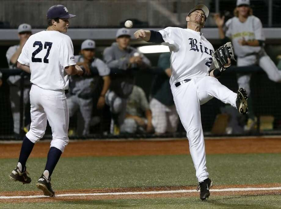 Rice third baseman Shane Hoelscher, right, throws after fielding a bunt attempt by Oregon during Rice's 1-0 victory over Oregon. At left is Rice pitcher Jordan Stephens. Photo: Brian Davies