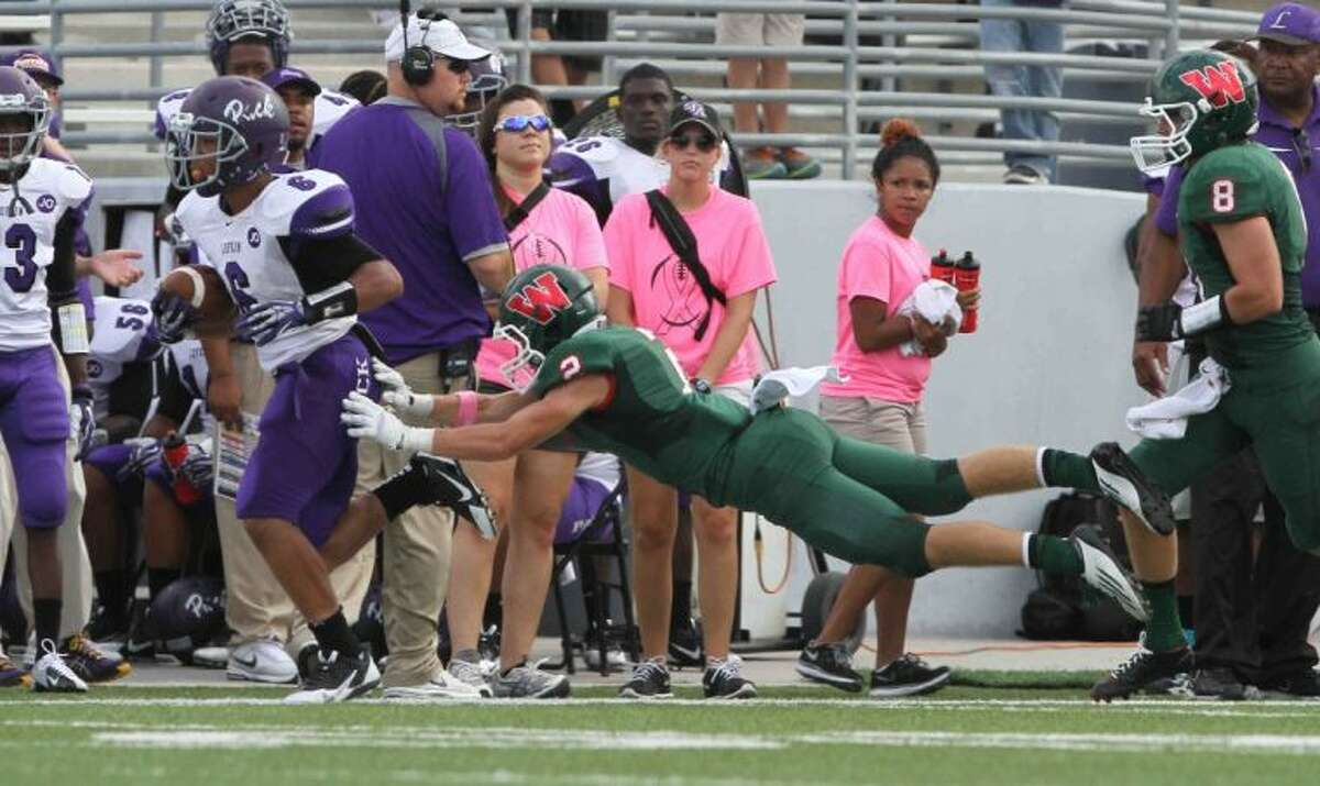 The Woodlands defensive back T.C. Schneider dives to force Lufkin running back Steven Sowell out of bounds Saturday at Woodforest Bank Stadium in Shenandoah. To view or purchase this photo and others like it, visit HCNpics.com.