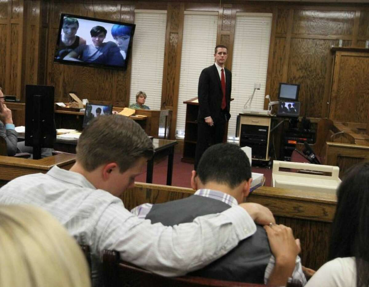 David Porras is comforted by friends and family as Montgomery County Assistant District Attorney Andrew James makes his closing argument during the sentencing of Nicole Baukus in the 435th state District Court of Judge Michael T. Seiler in August.