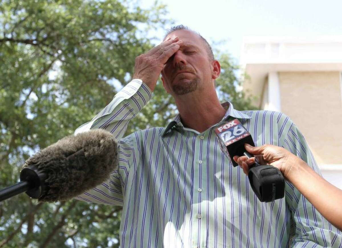 Fred Saunders, whose son Travis was killed after a drunk driving accident on Jun 29, 2012, shows emotion while talking to the media during the sentencing of Nicole Baukus in the 435th state District Court of Judge Michael T. Seiler Friday. Baukus pleaded guilty for two counts of intoxication manslaughter and one count of intoxication assault after driving her Ford F-150 pickup truck the wrong way on Interstate 45 and killing two people and injuring another.