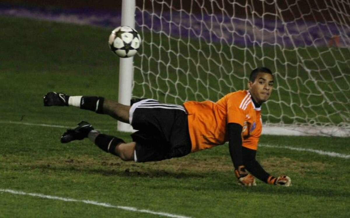 Willis goalkeeper Angel Juarez makes one of his 10 saves during a District 39-4A match Wednesday at Berton A. Yates Stadium. To view or purchase this photo and others like it, visit HCNpics.com.