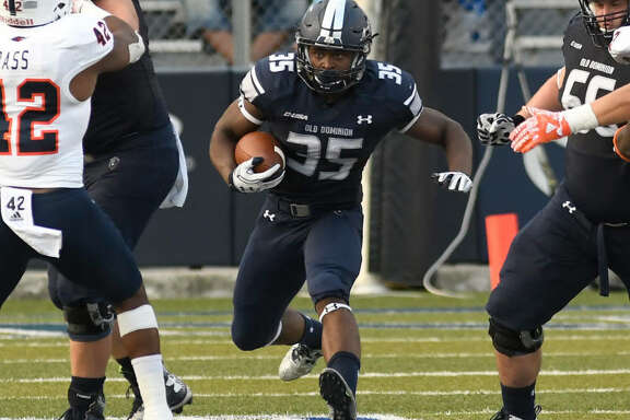 Old Dominion running back Jeremy Cox blows through a hole while on his way to a career-high 103 rushing yards and two scores in Saturday's win over UTSA.