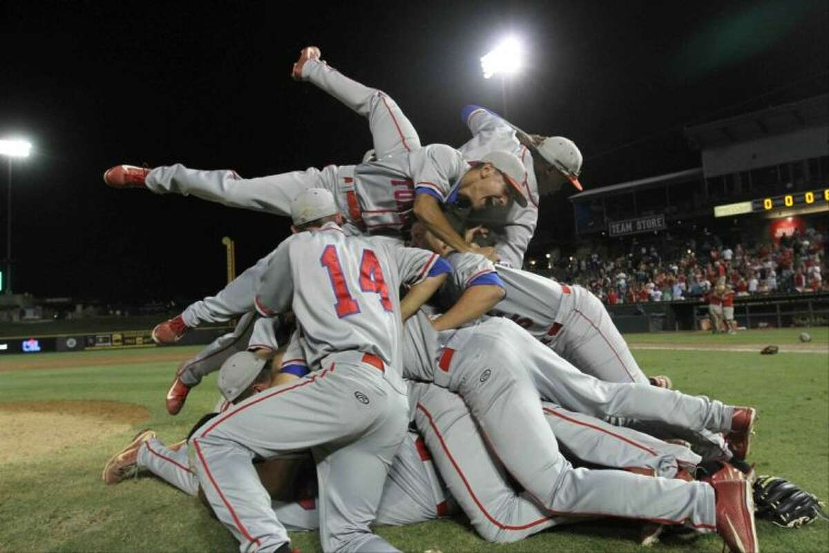 Tomball players celebrate after defeating Corpus Christi Moody 6-1 during the Class 4A UIL state baseball championship game on Friday, June 7, 2013, at Dell Diamond in Round Rock, Texas. Go to HCNPics.com to view and purchase this photo, and others like it.