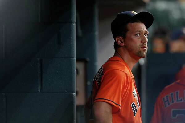 Houston Astros relief pitcher Luke Gregerson (44) reacts in the dugout after giving up several runs during the eighth inning of an MLB game at Minute Maid Park, Saturday, Sept. 24, 2016 in Houston.