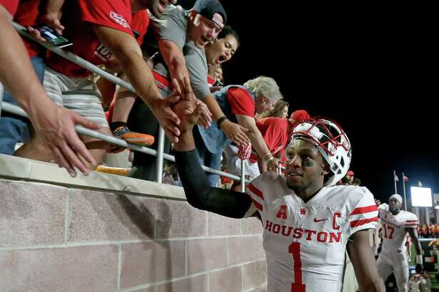 Houston Cougars quarterback Greg Ward Jr. celebrates with fans after the game with the Texas State Bobcats Saturday Sept. 24, 2016 at Bobcat Stadium in San Marcos, Tx. The Houston Cougars won 64-3.
