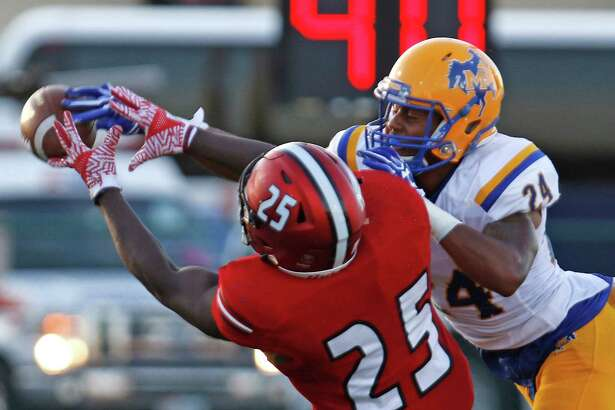 McNeese State's Damion Morgan (right) deflects a pass away from UIW's Broderick Reeves.