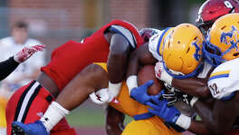 McNeese's Ryan Ross is upended by UIW players in UIW vs. McNeese State at Benson Stadium on Saturday, 9.24.2016.