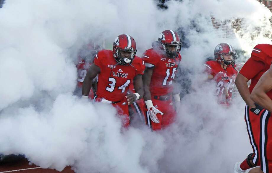 UIW football players take the field to before kickoff against McNeese State at Benson Stadium on Sept. 24, 2016. Photo: Ron Cortes /For The Express-News
