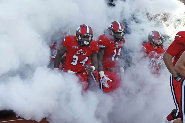 UIW football players take the field to before kickoff against McNeese State at Benson Stadium on Sept. 24, 2016.