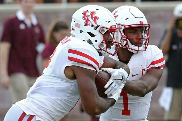 Houston Cougars running back Duke Catalon (left) takes the handoff from quarterback Greg Ward Jr. during first half action against the Texas State Bobcats Saturday Sept. 24, 2016 at Bobcat Stadium in San Marcos, Tx.
