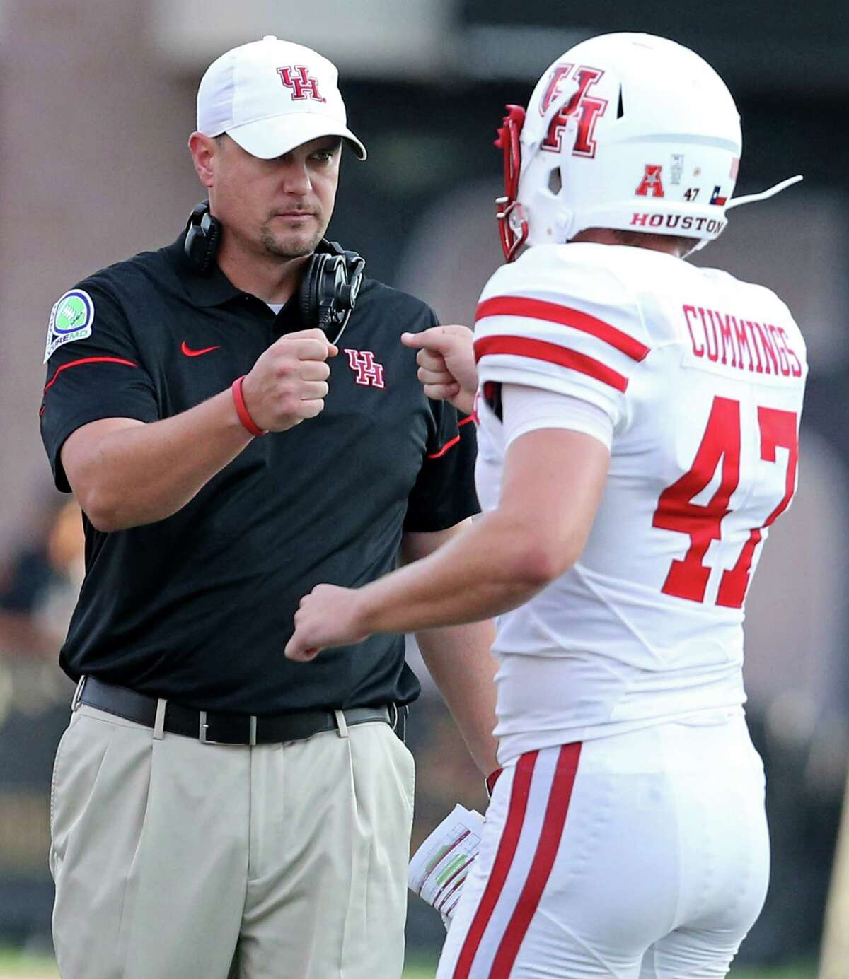 Houston Cougars head coach Tom Herman fist bumps Houston Cougars place kicker Ty Cummings after a field goal during first half action against the Texas State Bobcats Saturday Sept. 24, 2016 at Bobcat Stadium in San Marcos, Tx.