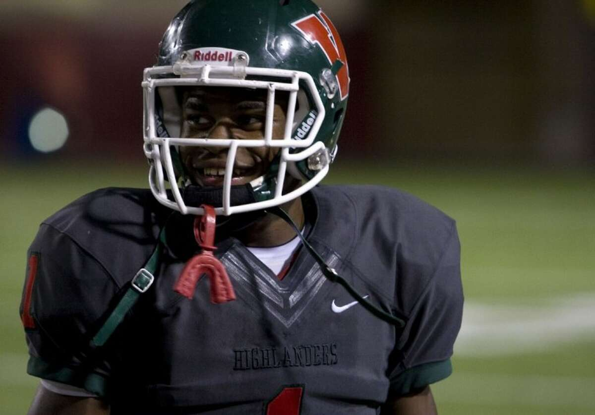 The Woodlands running back Patrick Carr is all smiles after his 265-yard, five touchdown performance against Oak Ridge at Woodforest Bank Stadium on Friday in Shenandoah.
