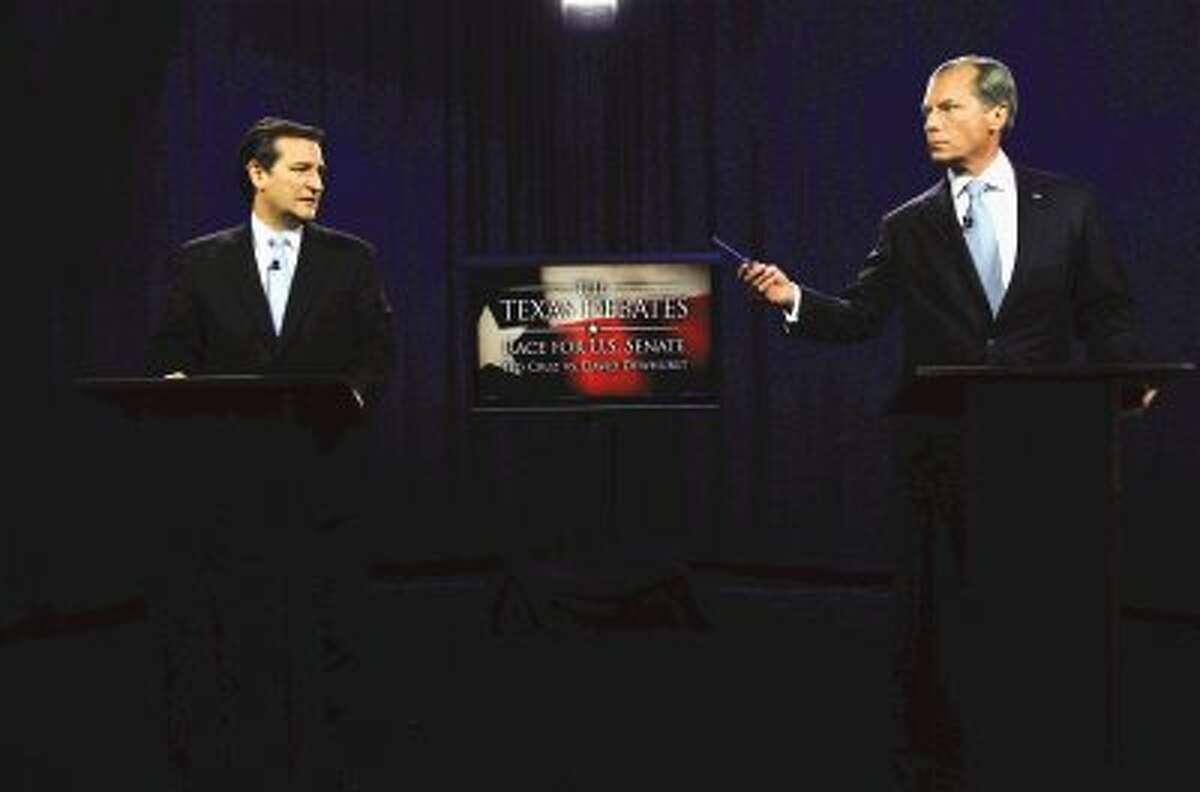 U.S. Senate Candidates Ted Cruz, left, and Texas Lt. Gov. David Dewhurst take their places before their televised debate in Dallas, June 22.
