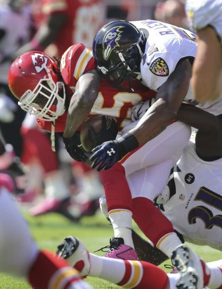 Baltimore Ravens linebacker Ray Lewis, here bringing down Kansas City's Jamaal Charles, has been lost for the season with a torn triceps. Photo: Ed Zurga