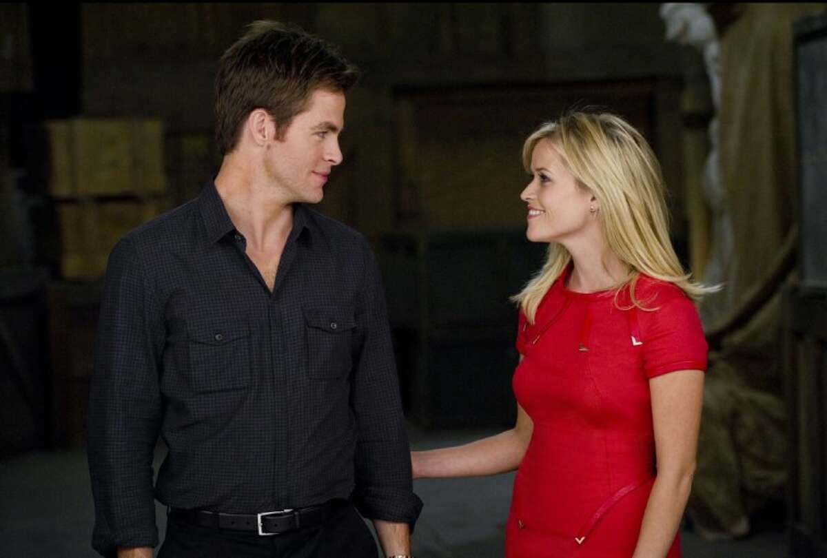 """In this film image released by 20th Century Fox, Reese Witherspoon, right, and Chris Pine are shown in a scene from """"This Means War."""""""