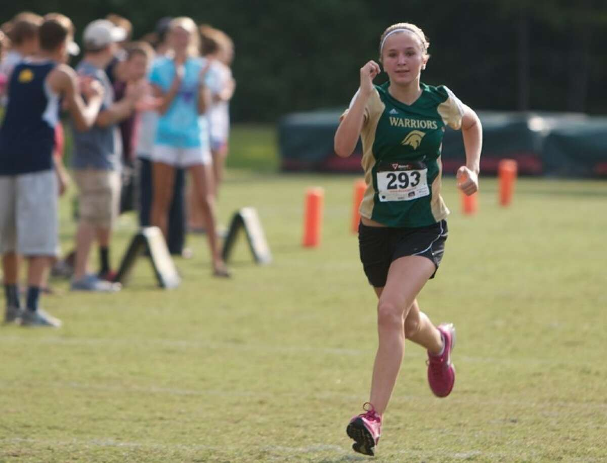 The Woodlands Christian Academy's Riley Farra, who took seventh individually, pushes toward the finish line in the 3200-meter event during Saturday's cross country meet held at The Woodlands Christian Academy campus in The Woodlands.