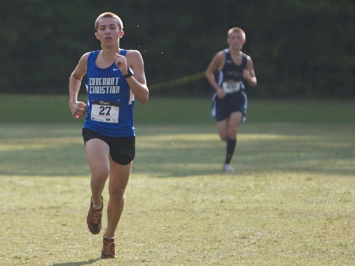 Covenant Christian's John Paul Bledsoe, who finished fourth individually, pushes to the finish line during Saturday's cross country meet held at The Woodlands Christian Academy campus in The Woodlands.