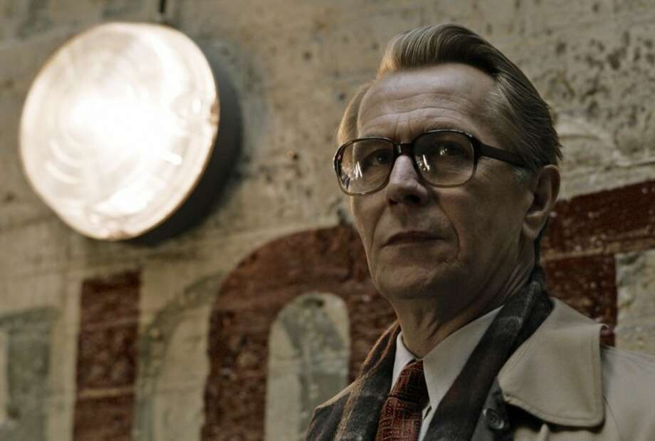"With his oversized glasses and overly polite demeanor, the owlish George Smiley is the highbrow antithesis of James Bond in ""Tinker Tailor Soldier Spy."" Photo: Jack English"