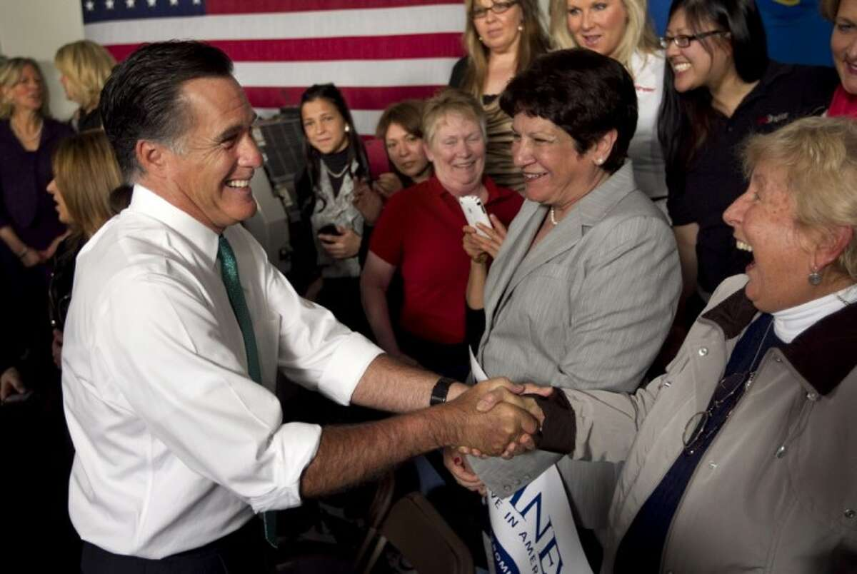 Republican presidential candidate and former Massachusetts Gov. Mitt Romney greets audience members at the conclusion of a campaign event in Hartford, Conn., Wednesday.