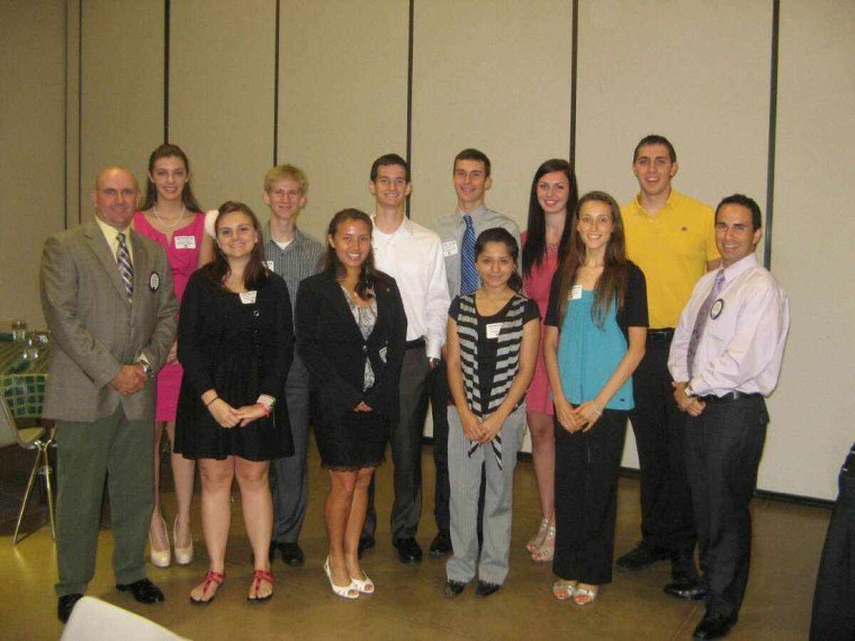The Conroe Noon Lions Club awarded $34,000 in college scholarships to area seniors. Some of those attended the club luncheon May 30 (from left to right) were: front row - President Philip Dupuis, Kathryn Williams, Celina Staten, Jennifer Vega, Kristina Wear, Lion Kala Eulitt; back row - Rebecca Stanley, Ryan Durham, Connor Black, Keith Tamborello, Adrien Wohlschlaeger and David Jung.