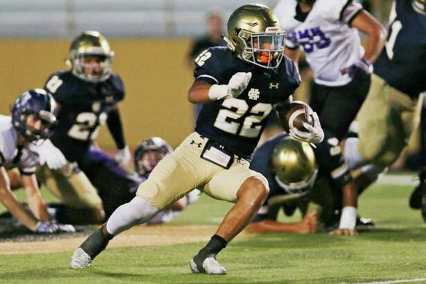 Holy Cross' Jaime Ramirez finds room to run during the first half of their game with Saint Mary's Hall at Harlandale Memorial Stadium on Sept. 24, 2016.