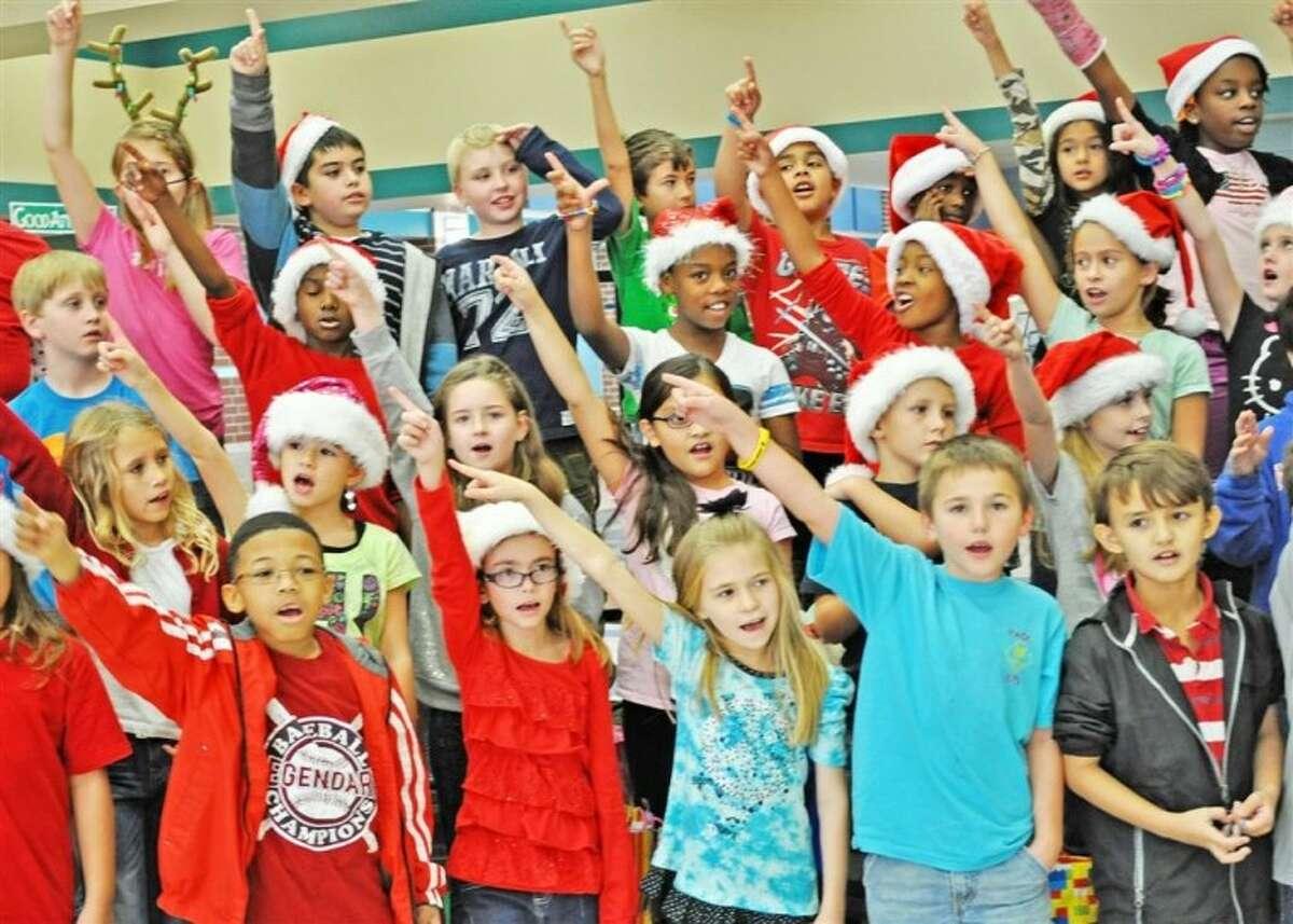 Birnham Woods Elementary Choir members performed holiday carols.