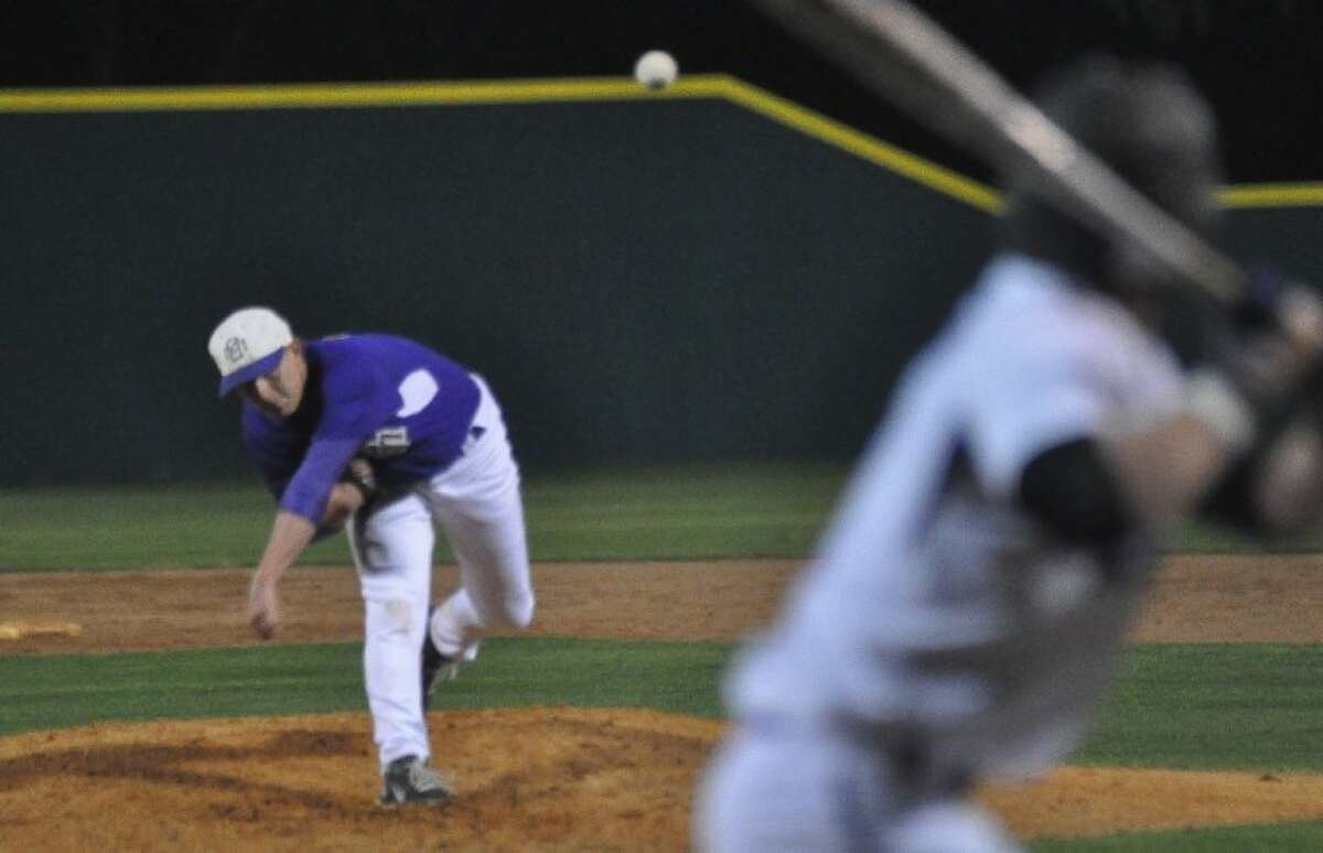 Montgomery's Ty Boland fires home during a non-district game against Willis on Monday at the Willis athletic complex.