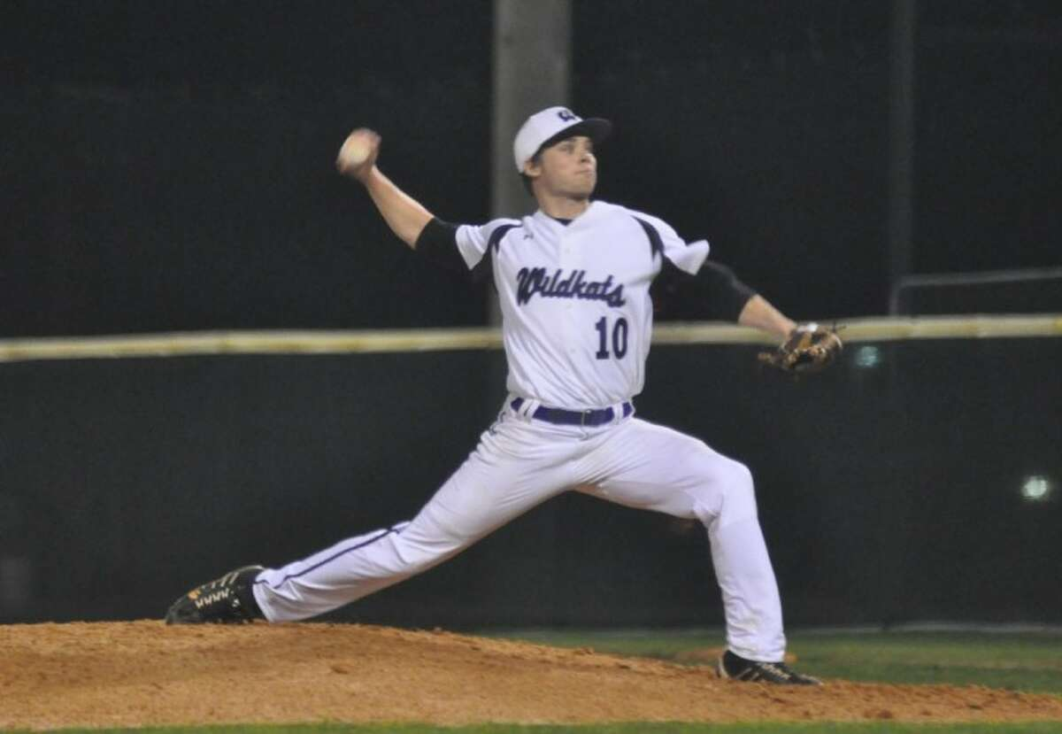 Willis' Cameron Johnson fires home during a non-district game against Montgomery on Monday at the Willis athletic complex.