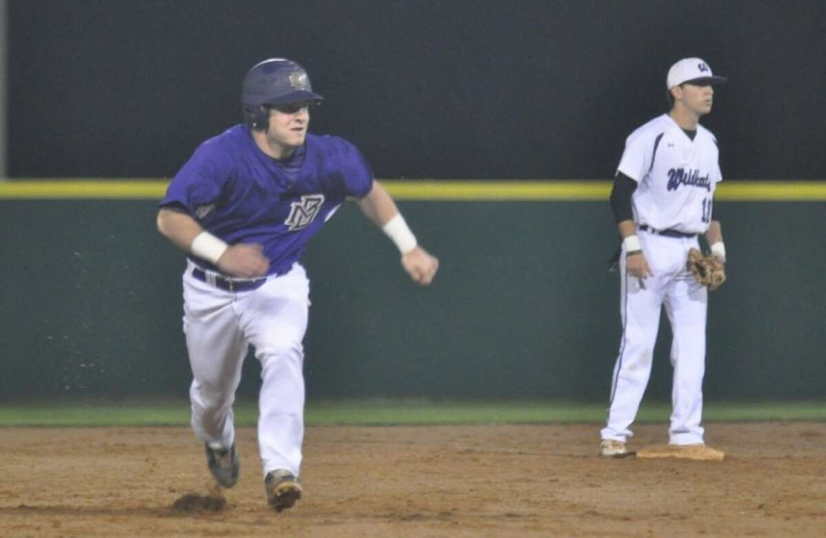 Montgomery's Jeffrey Elliot makes a dash for third base during a non-district game against Willis on Monday at the Willis athletic complex.