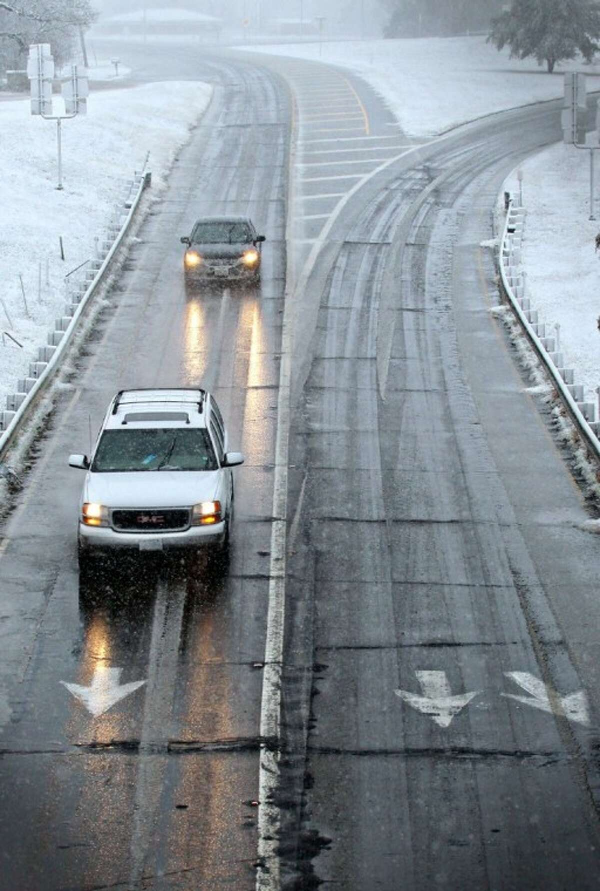 Drivers maneuver wet and icy roads in Paris, Texas, Tuesday after a strong winter system dropped inches of rain and snow on most of northeast Texas.