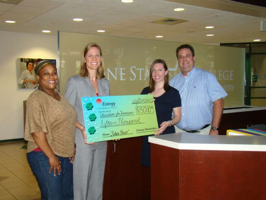 Elaine Christian and Monica Bomkamp Enia, of EfTA, receive a $15,000 check from Entergy's Melissa Bochat and Kelley Carson.