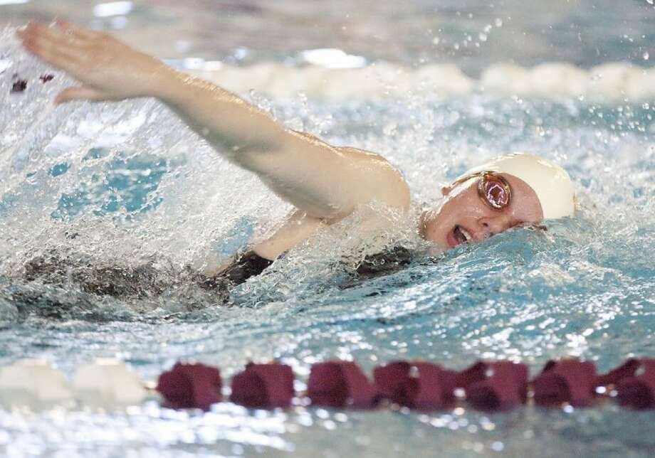 Magnolia West's Jessica Sloan competes in the 500-Yard Freestyle during the Region Swimming Championships Saturday at the Michael D. Holland Aquatic Center in Magnolia. See more photos online at www.yourconroenews.com/photos. Photo: Karl Anderson
