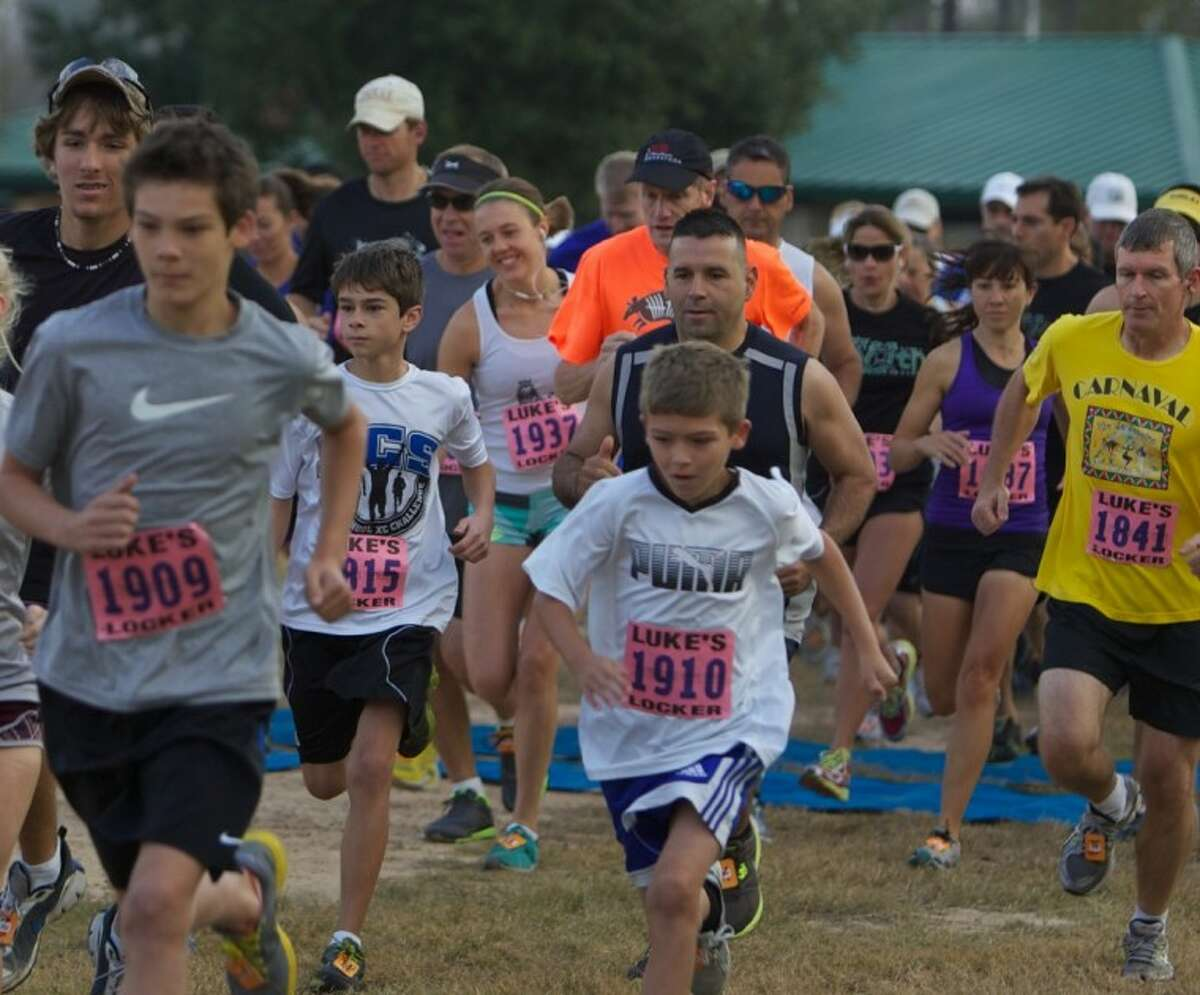 Runners take off at the start of the Eighth Annual Turkey Trot 5K Run at Carl Barton Jr. Park in Conroe Friday.