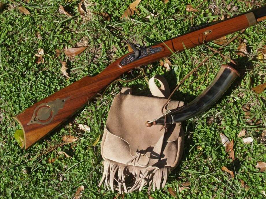 This is a frontiersman's dream: my Hawken .50 caliber muzzleloader with possible bag and powder horn.