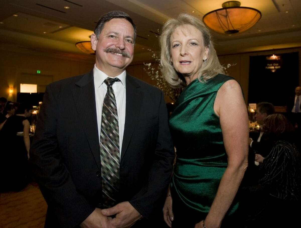 Outgoing Chairman Charlie Irvine, left, of Signs Etc., and Incoming Chairman Helen Thornton, of Thornton Financial Services, stand for a photograph during Saturday's Greater Conroe/Lake Conroe Area Chamber of Commerce's annual Chairman's Ball at The Woodlands Waterway Marriott in The Woodlands.