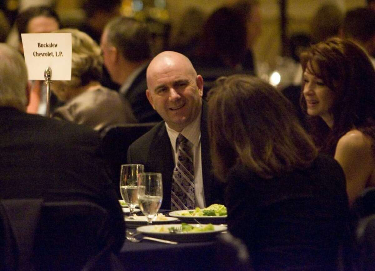 Conroe Police Chief Philip Dupuis enjoys a dinner during Saturday's Greater Conroe/Lake Conroe Area Chamber of Commerce's annual Chairman's Ball at The Woodlands Waterway Marriott in The Woodlands.