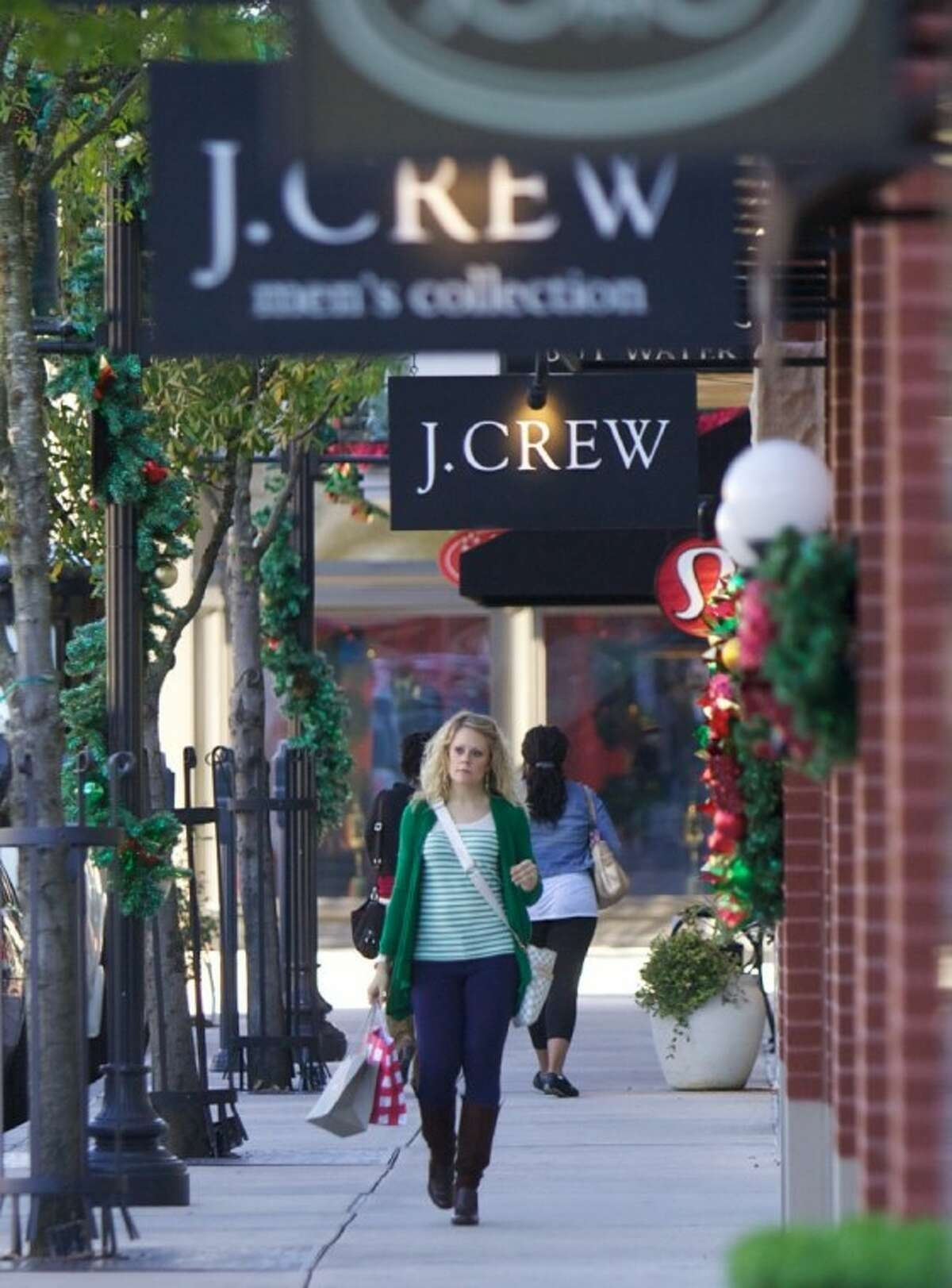 Shoppers make their way down Market Street in The Woodlands on Tuesday morning as the holiday shopping season goes into full swing.