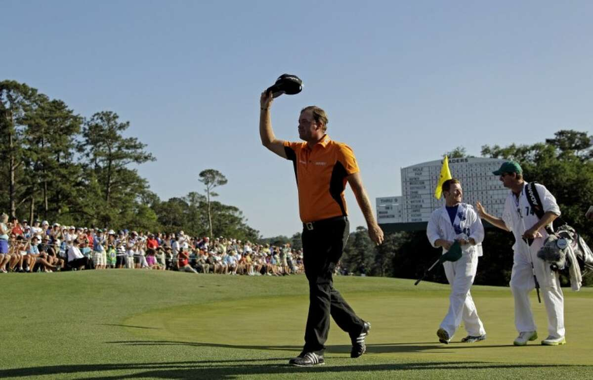 Peter Hanson, of Sweden, salutes the gallery as he walks up to the 18th green during the third round of the Masters golf tournament Saturday in Augusta, Ga.