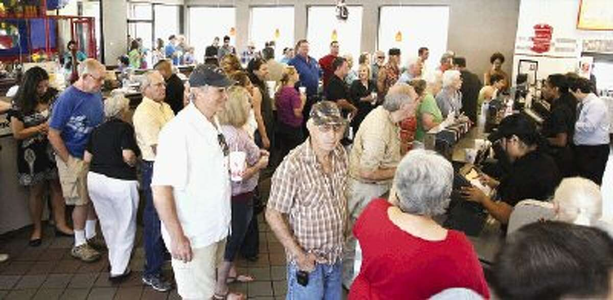 Hundreds of customers wait in line at the Chick-fil-A throughout Montgomery County Wednesday in support of Chick-fil-A Appreciation Day.