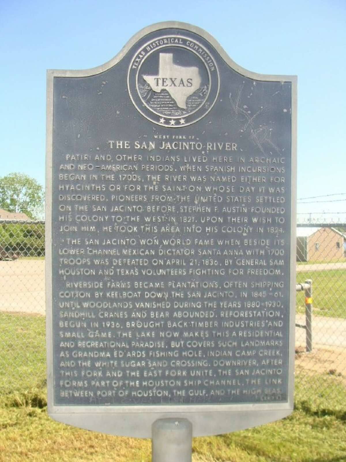 A historical marker for the San Jacinto River is situated at the start of the Lake Conroe Dam behind the U.S. Coast Guard Auxiliary on Texas 105.