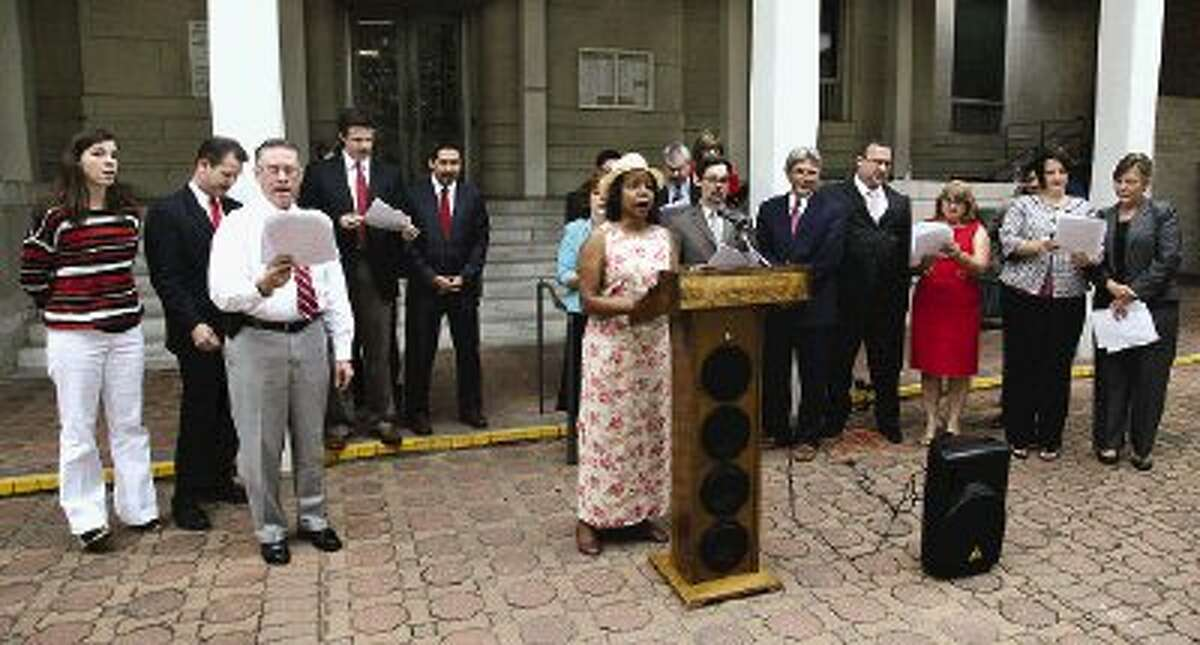 Two dozen judges and criminal defense attorneys gathered to read the Declaration of Independence on the steps of the Montgomery County Courthouse Tuesday.