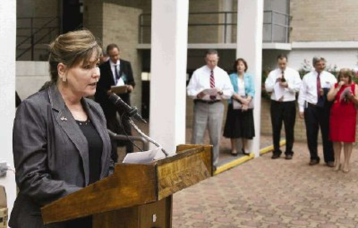 Doris Golemon, chief of staff for Montgomery County Judge Alan Sadler, was the first of two dozen speakers to read the Declaration of Independence on the Montgomery County Courthouse steps Tuesday.