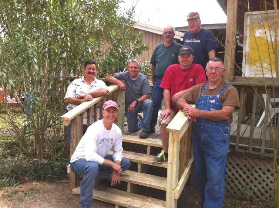 Members of the Conroe Noon Lions show off the new steps they replaced last weekend at Bridgewood Farms. Pictured (top row, left to right) are: Charlie Irvine, Bruce Wade, Reggie Coots, Bob Gunter, Keith Henderson, Paul Kleinpeter; and (bottom) club President Rich Sproba.