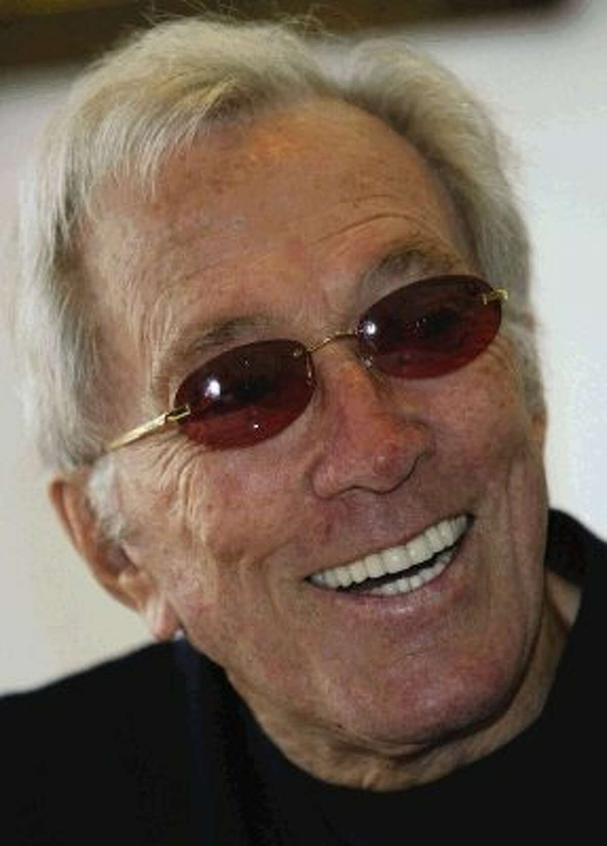 """In this July 25, 2004 file photo, U.S. singer Andy Williams smiles as he speaks to reporters during his news conference at a Tokyo hotel. Emmy-winning TV host and """"Moon River"""" crooner Williams died Tuesday night at his home in Branson, Mo., following a year-long battle with bladder cancer. He was 84."""