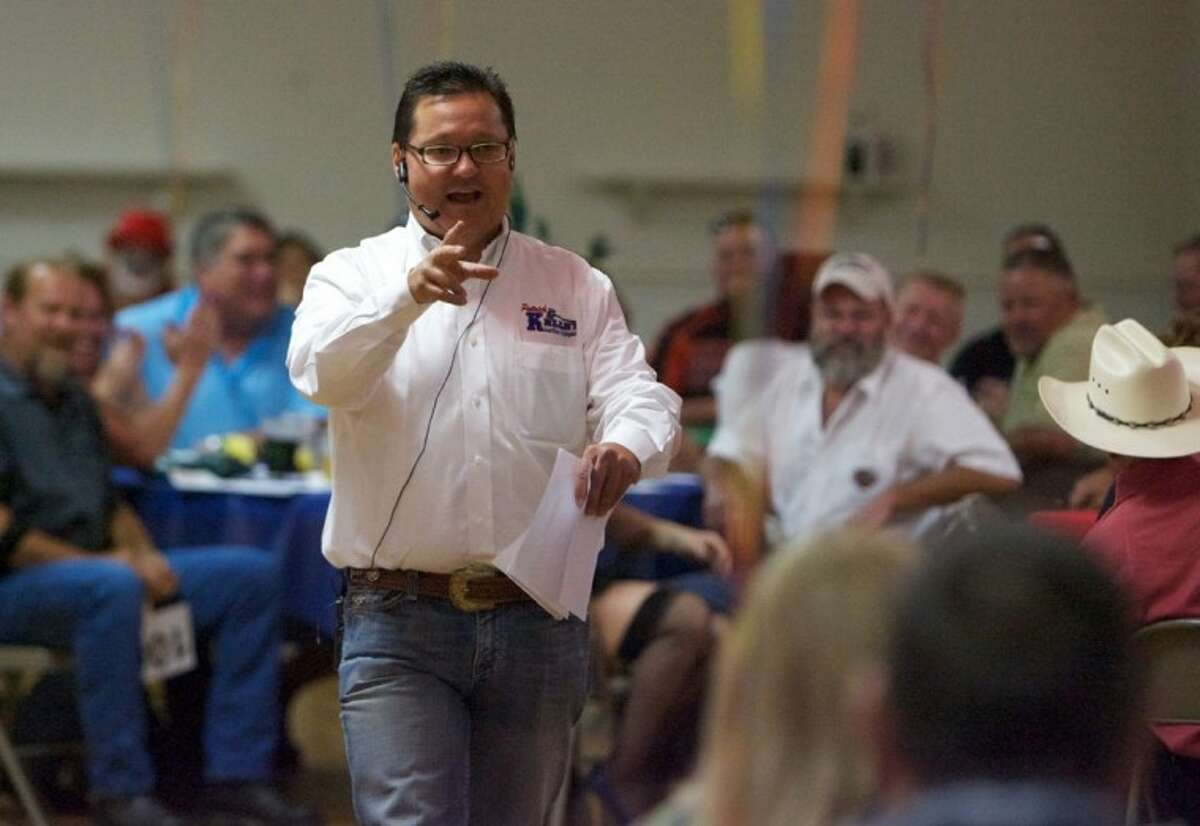 Auctioneer Patrick Kelly keeps a lookout for bids during the 10th Annual Toy Run Auction held Saturday at the Lake Conroe KOA in Montgomery.