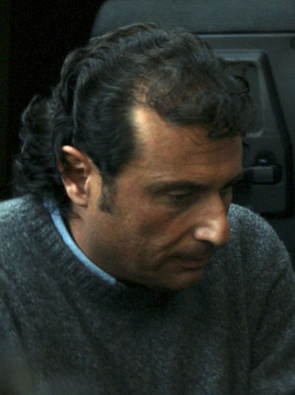 Francesco Schettino, the captain of the Costa Concordia cruise ship that run aground the tiny Island of Giglio last Friday, leaves the Grosseto court, Italy, Tuesday.