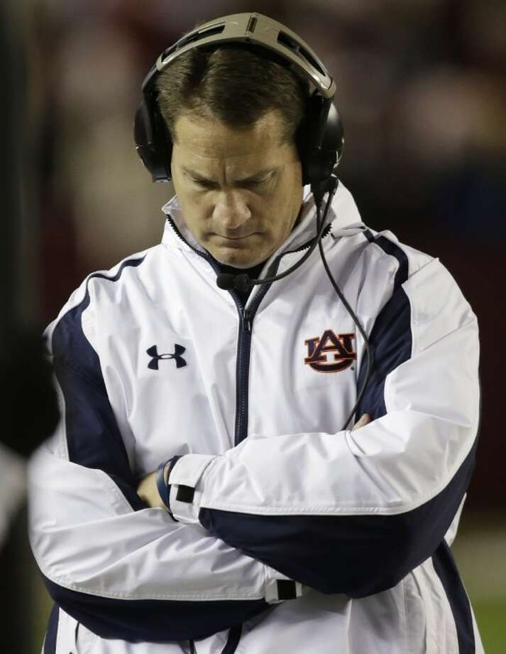 Auburn coach Gene Chizik has been fired after a 3-9 season, including a winless campaign in SEC play. Photo: Dave Martin