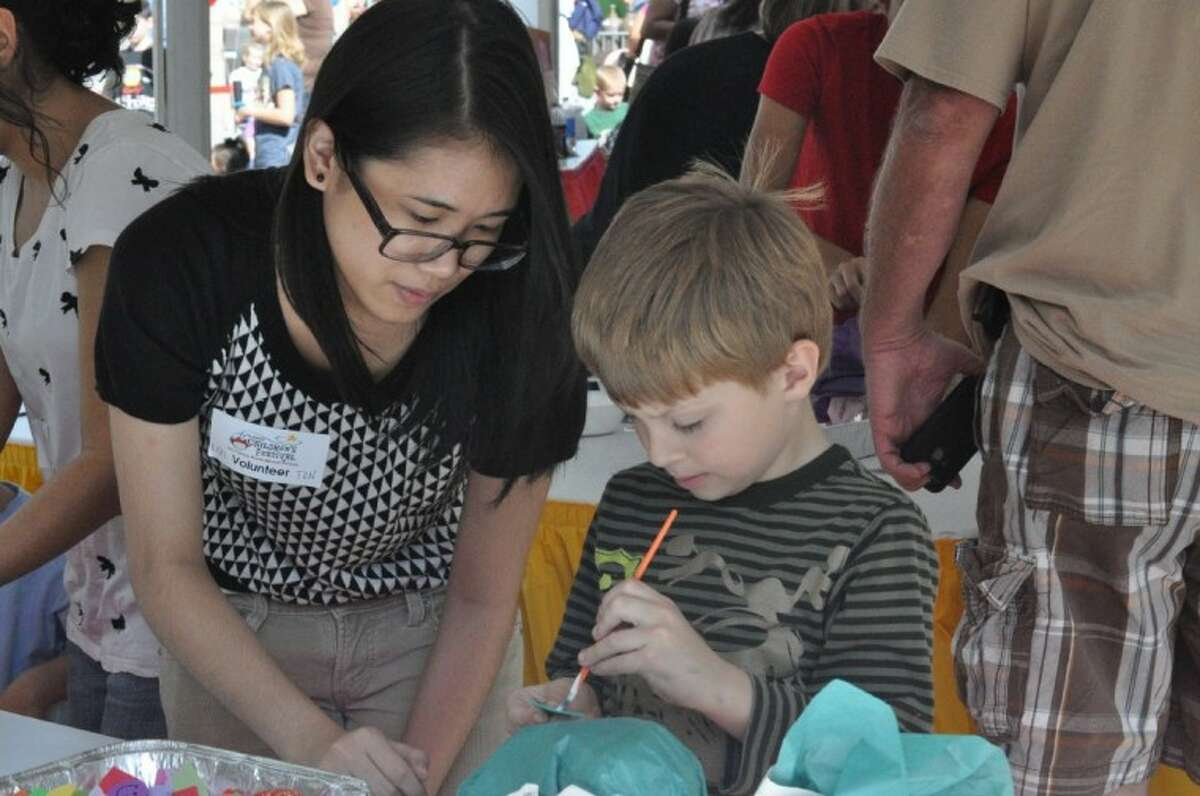 Visitors to The Cynthia Woods Mitchell Pavilion Saturday enjoyed fun children's activities, musical acts and more during the annual Children's Festival, which continues today.