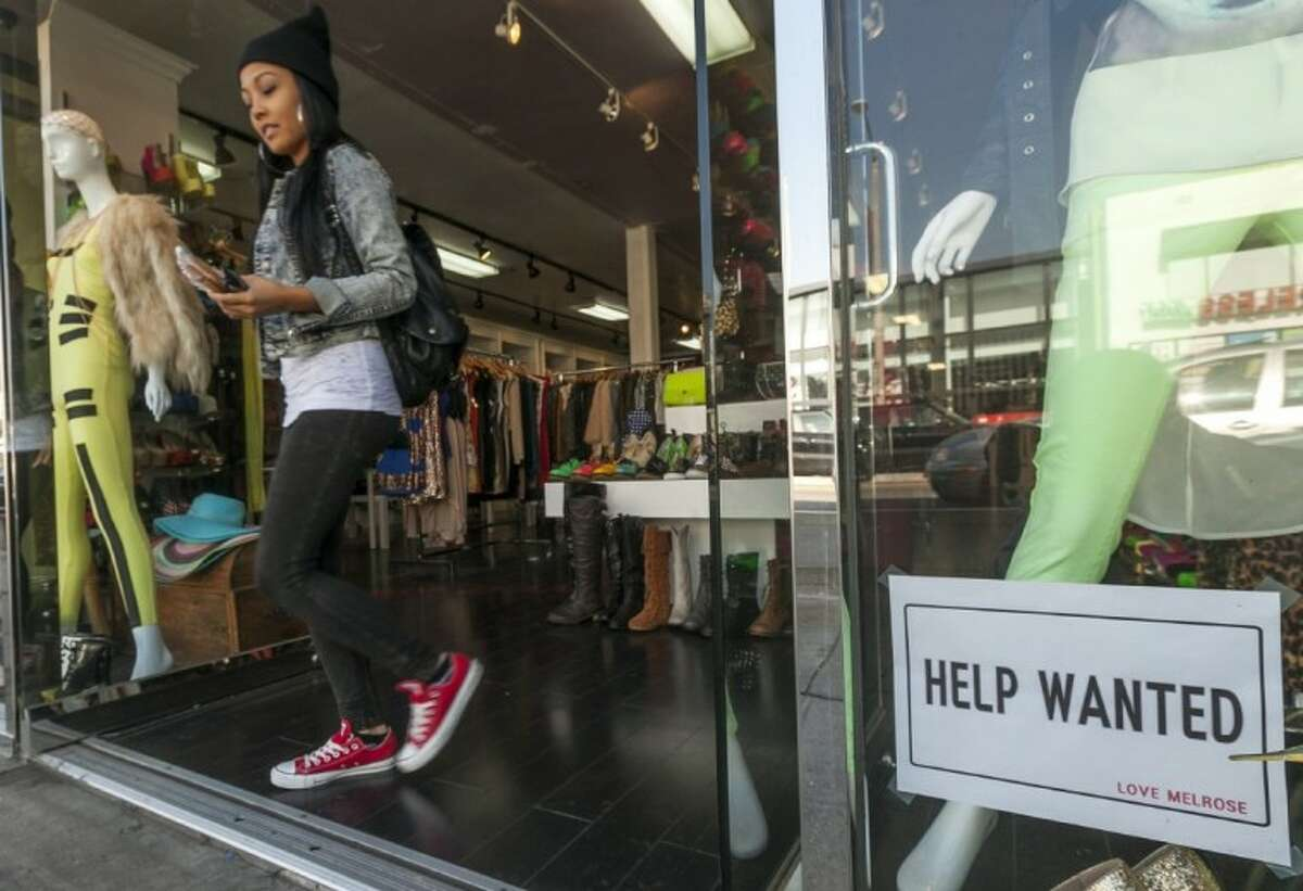 A help wanted sign is posted on the front window of a clothing boutique in Los Angeles Friday. The U.S. economy added a solid 146,000 jobs in November and the unemployment rate fell to 7.7 percent, the lowest since December 2008, the Labor Department announced Friday.